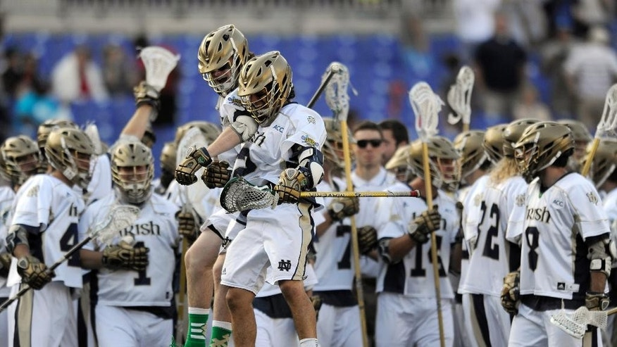 Notre Dame's John Scioscia, right, and Matthew Collins, left, celebrate their 11-6 win over Maryland in the semifinals of the NCAA Division 1 lacrosse tournament Saturday, May 24, 2014, in Baltimore.(AP Photo/Gail Burton)
