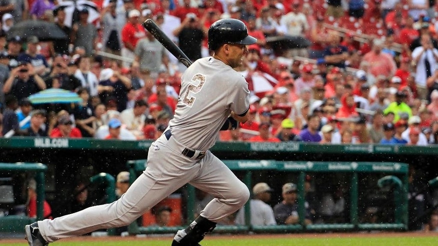 New York Yankees' Derek Jeter singles during the first inning of a baseball game against the St. Louis Cardinals Monday, May 26, 2014, in St. Louis. (AP Photo/Jeff Roberson)
