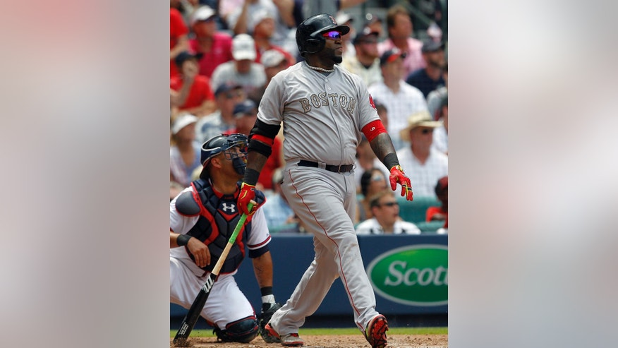 Boston Red Sox's David Ortiz (34) watches his three run homer during the fifth inning of a baseball game against the Atlanta Braves on Monday, May 26, 2014, in Atlanta, Ga. (AP Photo/Butch Dill)