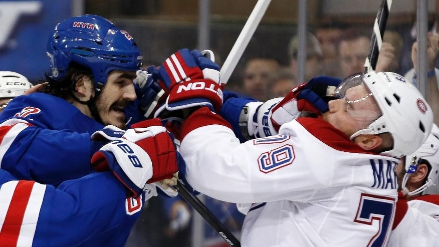 New York Rangers center Brian Boyle and Montreal Canadiens defenseman Andrei Markov (79), of Russia, fight during the second period of Game 4 of the NHL hockey Stanley Cup playoffs Eastern Conference finals, Sunday, May 25, 2014, in New York. (AP Photo/Kathy Willens)