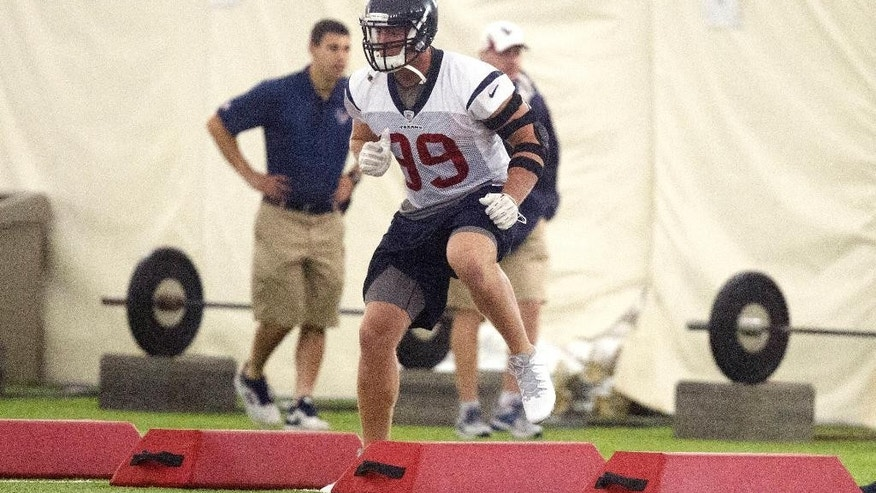 Houston Texans defensive end J.J. Watt runs through drills during an NFL football minicamp, Tuesday, May 27, 2014, in Houston. (AP Photo/Patric Schneider)