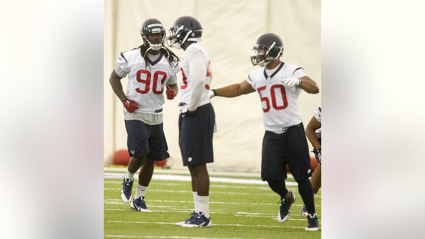 Houston Texans outside linebacker Jadeveon Clowney (90) runs through drills during an NFL football minicamp, Tuesday, May 27, 2014, in Houston. (AP Photo/Patric Schneider)