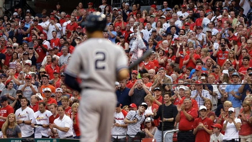 Fans give New York Yankees' Derek Jeter a standing ovation as he comes up to bat during the first inning against the St. Louis Cardinals on Tuesday, May 27, 2014, in St. Louis. (AP Photo/Jeff Roberson)