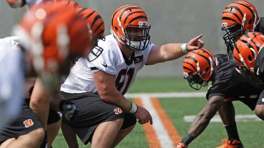 Cincinnati Bengals fourth round draft pick Russell Bodine, a center from North Carolina, calls a play during an NFL football organized team activity, Tuesday, May 27, 2014, in Cincinnati.  (AP Photo/Al Behrman)