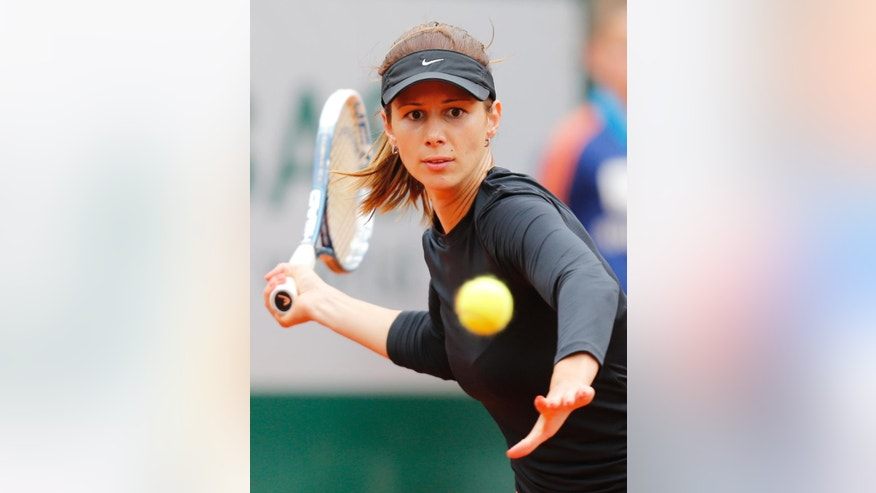 Bulgaria's Tsvetana Pironkova returns the ball to Russia's Maria Sharapova during the second round match of  the French Open tennis tournament at the Roland Garros stadium, in Paris, France, Wednesday, May 28, 2014. (AP Photo/David Vincent)