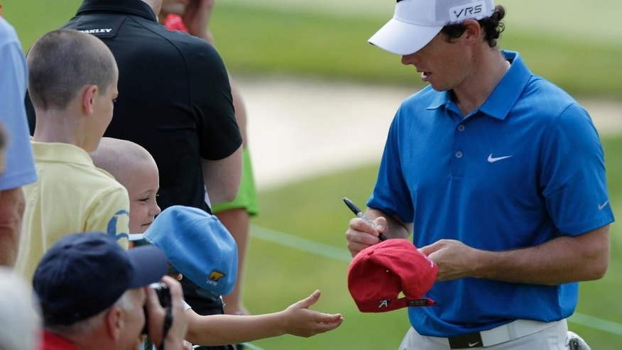 CORRECTS SPELLING TO MCILROY, INSTEAD OF MCILLROY - Rory McIlroy, of Northern Ireland, signs autographs for fans during the pro-am for the the Memorial golf tournament Wednesday, May 28, 2014, in Dublin, Ohio. (AP Photo/Jay LaPrete)