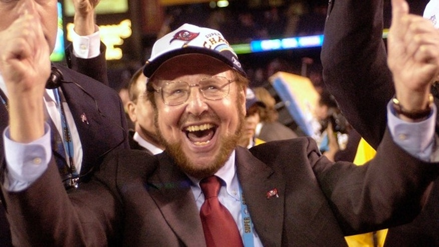 Jan. 26, 2003: Tampa Bay Buccaneers owner Malcolm Glazer celebrates the Bucs' 48-21 victory over the Oakland Raiders in Super Bowl XXXVII in San Diego.