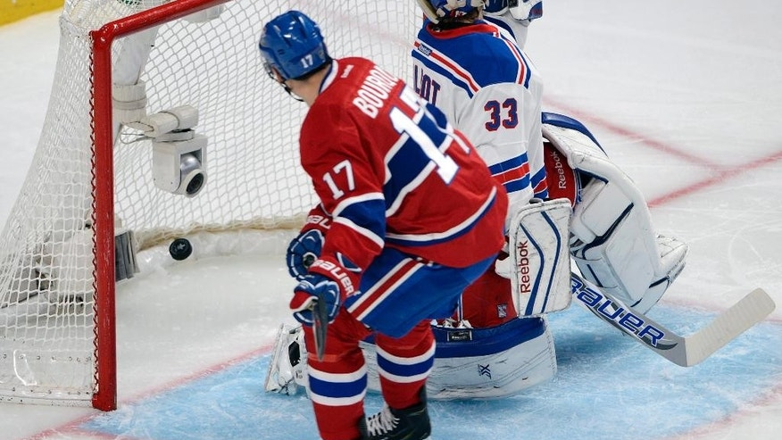 Montreal Canadiens left wing Rene Bourque (17) scores against New York Rangers goalie Cam Talbot (33) during the third period of Game 5 of the NHL hockey Stanley Cup playoffs Eastern Conference finals, Tuesday, May 27, 2014, in Montreal. (AP Photo/The Canadian Press, Ryan Remiorz)