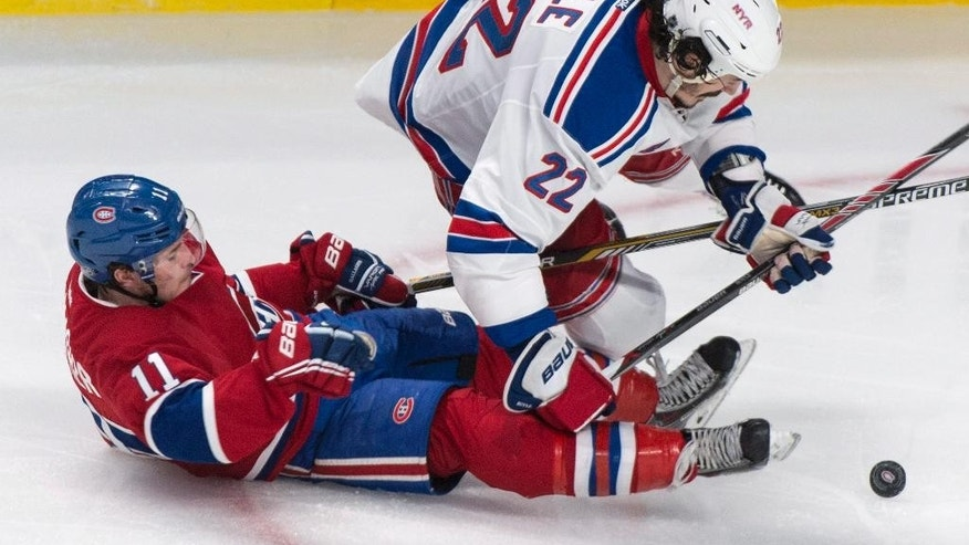 Montreal Canadiens' Brendan Gallagher and New York Rangers Brian Boyle fall during the second period of Game 5 of the NHL hockey Stanley Cup playoffs Eastern Conference finals, Tuesday, May 27, 2014, in Montreal. (AP Photo/The Canadian Press, Paul Chiasson)