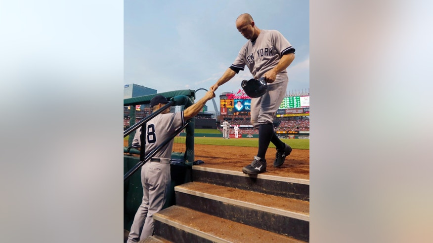 New York Yankees' Brett Gardner, right, is congratulated by manager Joe Girardi after scoring on a single by Jacoby Ellsbury during the third inning of a baseball game against the St. Louis Cardinals on Wednesday, May 28, 2014, in St. Louis. (AP Photo/Jeff Roberson)