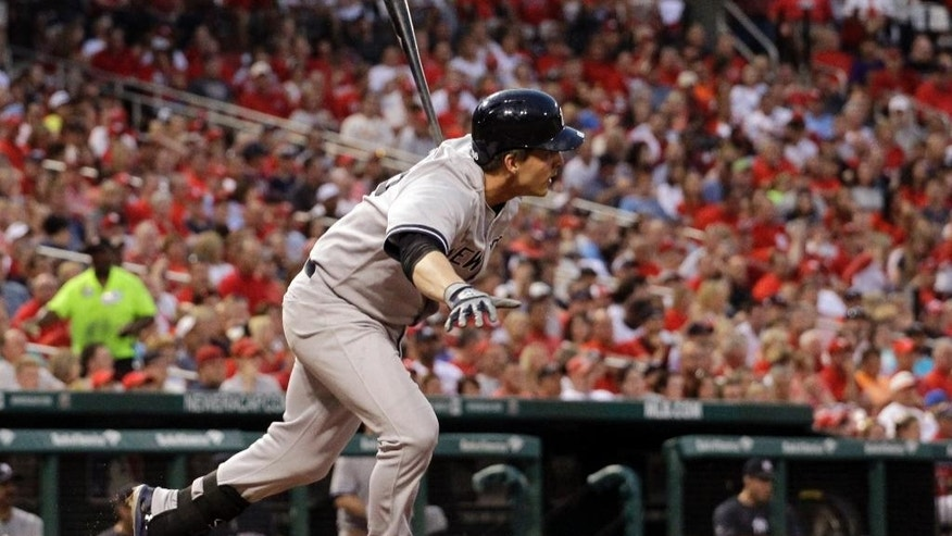 New York Yankees' John Ryan Murphy watches his two-run single during the third inning of a baseball game against the St. Louis Cardinals on Wednesday, May 28, 2014, in St. Louis. (AP Photo/Jeff Roberson)