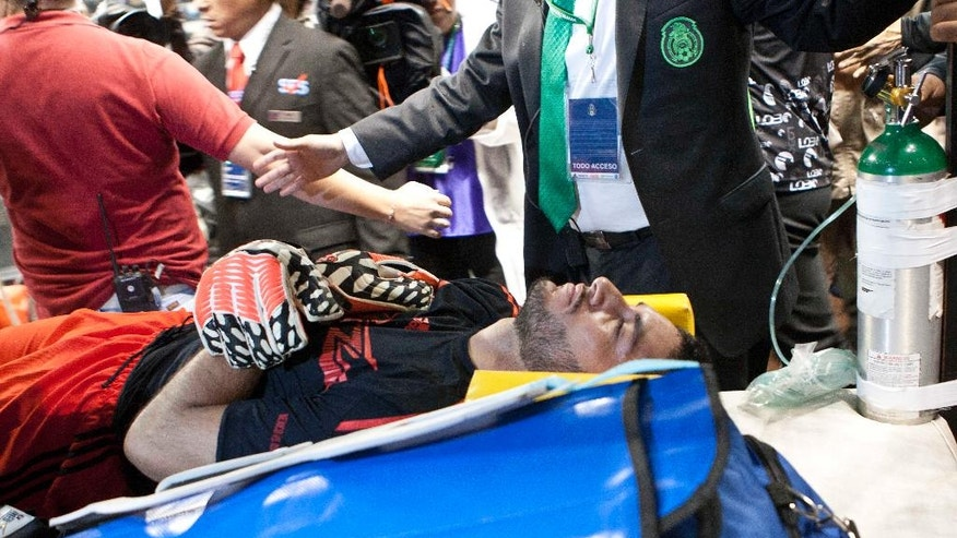 Mexico's goalkeeper Jesus Corona is taken out of the pitch in a stretcher after suffering an injury, during a friendly match against Israel in Mexico City, Wednesday, May 28, 2014. (AP Photo/Christian Palma)