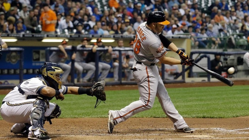 Baltimore Orioles' Steve Pearce hits a three-run home run during the seventh inning of a baseball game against the Milwaukee Brewers Tuesday, May 27, 2014, in Milwaukee. (AP Photo/Morry Gash)