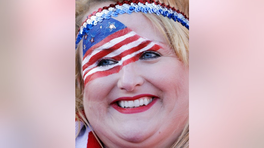 A fan has a American flag painted on her face as she waits for the start an international friendly soccer match between the United States and Azerbaijan on Tuesday, May 27, 2014, in San Francisco. (AP Photo/Marcio Jose Sanchez)