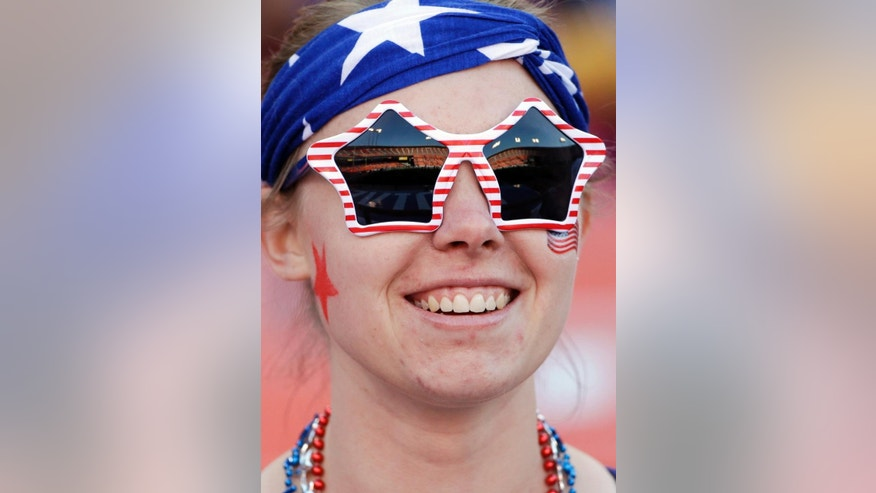 A fan wears glasses as she waits for the start of an international friendly soccer match between the United States and Azerbaijan on Tuesday, May 27, 2014, in San Francisco. (AP Photo/Marcio Jose Sanchez)