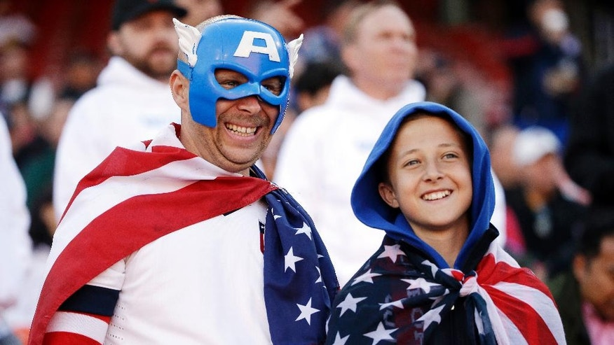 Fans watch players warm up before the start an international friendly soccer match between the United States and Azerbaijan on Tuesday, May 27, 2014, in San Francisco. (AP Photo/Marcio Jose Sanchez)