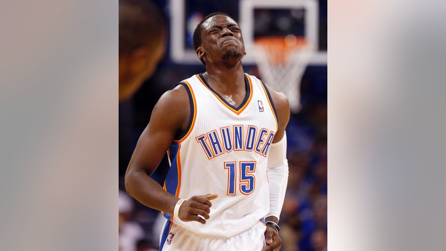 Oklahoma City Thunder guard Reggie Jackson grimaces as he limps back up the court after a fall in the first quarter of Game 4 of the Western Conference finals NBA basketball playoff series against the San Antonio Spurs in Oklahoma City, Tuesday, May 27, 2014. (AP Photo/Sue Ogrocki)