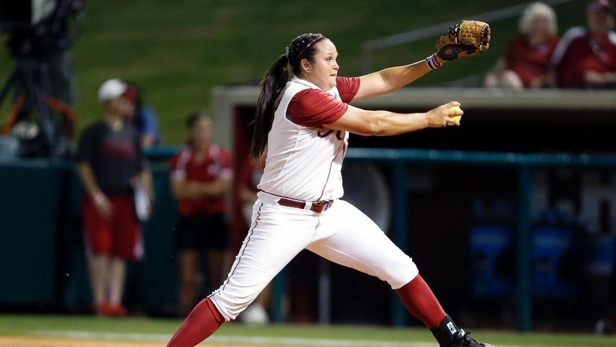 FILE - In this May 22, 2014 file photo, Alabama's Jaclyn Traina pitches against Nebraska during an NCAA college softball tournament super regional in Tuscaloosa, Ala. Traina and Ryan Iamurri are trying to end their careers with a second title in three years at the Women's College World Series, which starts Thursday, May 29, 2014.  (AP Photo/The Tuscaloosa News, Michelle Lepianka Carter)