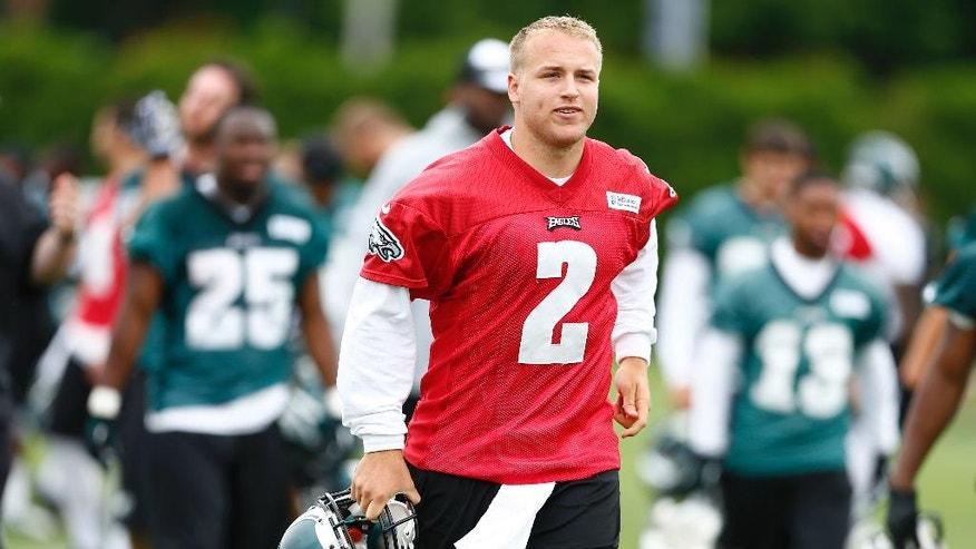 Philadelphia Eagles quarterback Matt Barkley runs off the field after an NFL football organized team activity Thursday, May 29, 2014, in Philadelphia. (AP Photo/Matt Rourke)