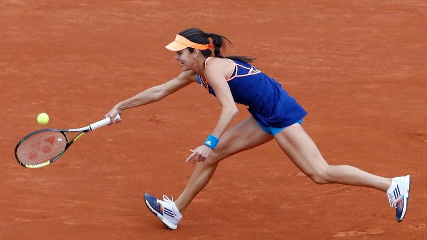 Serbia's Anna Ivanovic returns the ball during the second round match of the French Open tennis tournament against Ukraine's Elina Svitolina at the Roland Garros stadium, in Paris, France, Thursday, May 29, 2014. (AP Photo/Darko Vojinovic)