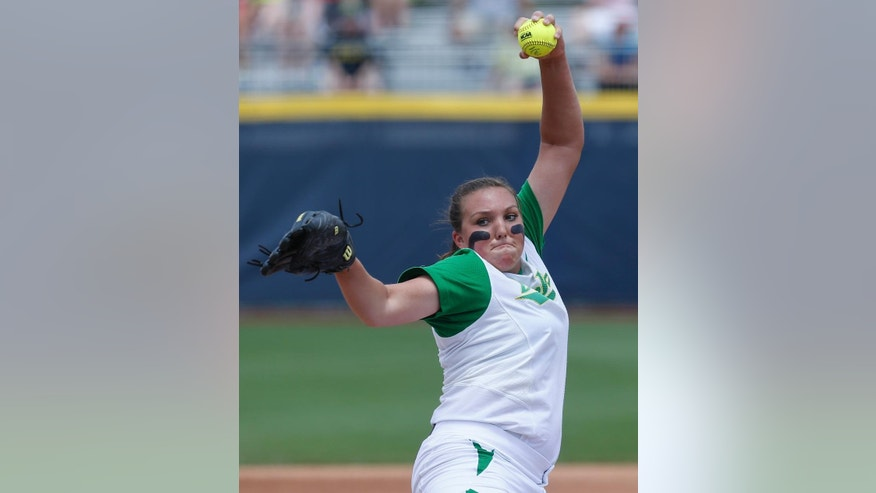 Oregon's Cheridan Hawkins pitches in the first inning of an NCAA Women's College World Series softball tournament game against Florida State in Oklahoma City, Thursday, May 29, 2014. (AP Photo/Sue Ogrocki)