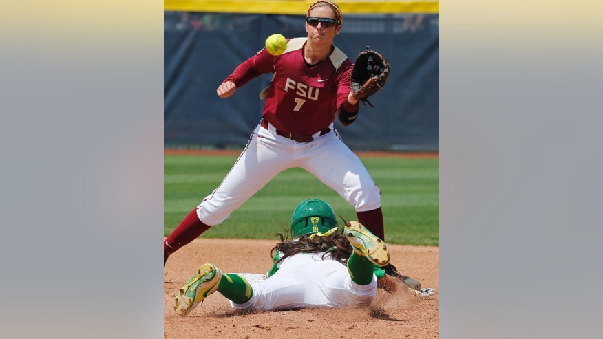 Oregon's Janie Takeda steals second base as Florida State shortstop Maddie O'Brien (7) waits for the throw in the third inning of an NCAA Women's College World Series softball tournament game in Oklahoma City, Thursday, May 29, 2014. (AP Photo/Sue Ogrocki)