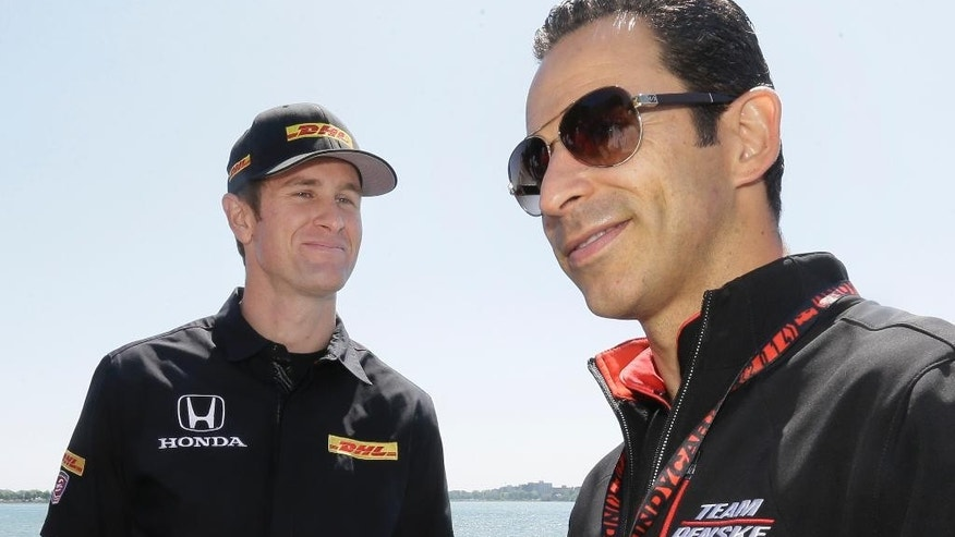 Ryan Hunter-Reay, left, the first American since 2006 to win the Indianapolis 500, talks with Helio Castroneves before a media event in Detroit, Thursday, May 29, 2014. Hunter-Reay will get two chances to sustain success when IndyCar hosts full-length races Saturday and Sunday in the Motor City. (AP Photo/Carlos Osorio)