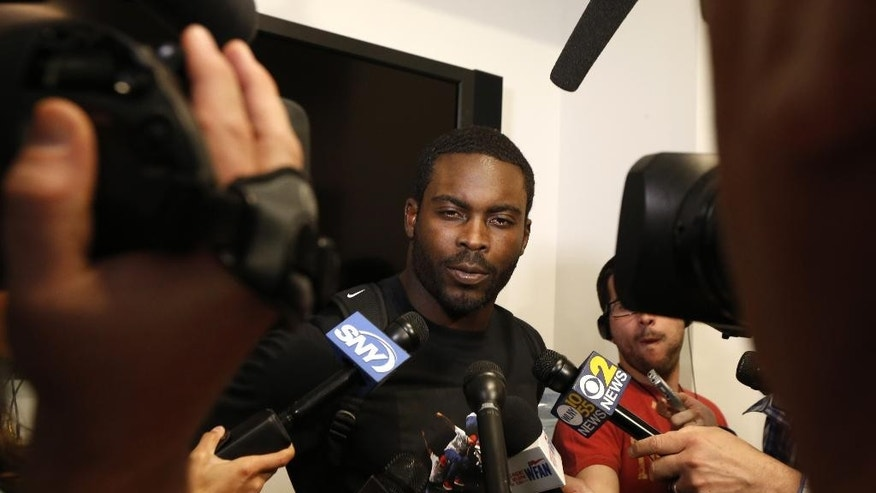New York Jets quarterback Michael Vick talks to reporters during an NFL football organized team activity, Wednesday, May 28, 2014, in Florham Park, N.J. (AP Photo/Julio Cortez)
