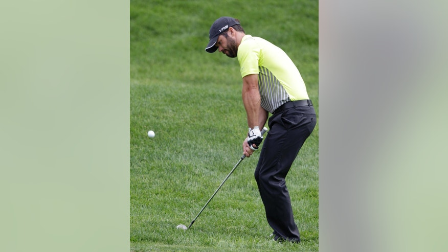 Paul Casey chips to the 11th green during the first round of the Memorial golf tournament Thursday, May 29, 2014, in Dublin, Ohio. (AP Photo/Jay LaPrete)