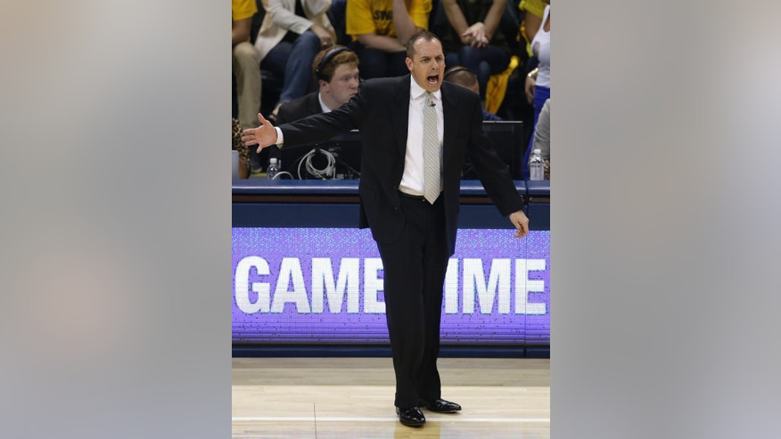 Indiana Pacers coach Frank Vogel argues a call during the first half of Game 5 of the Eastern Conference finals NBA basketball playoff series against the Miami Heat on Wednesday, May 28, 2014, in Indianapolis. (AP Photo/Darron Cummings)