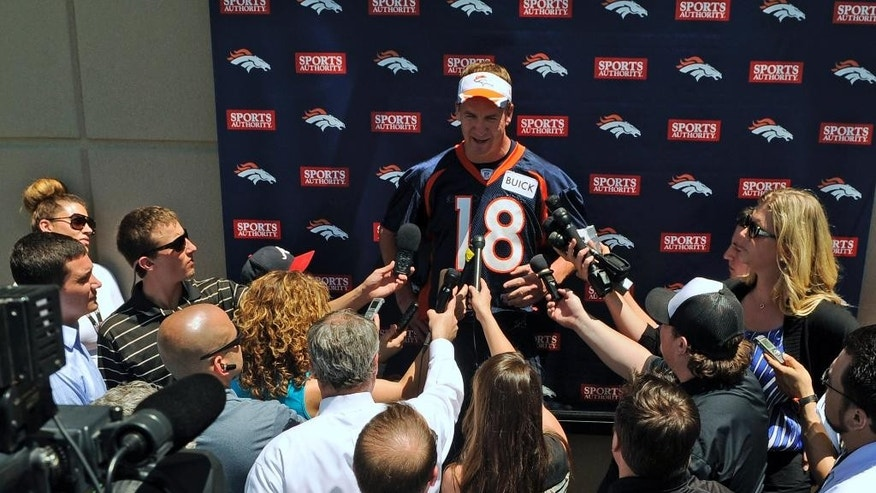 Denver Broncos quarterback Peyton Manning talks to the media following an NFL football organized team activity, Wednesday, May 28, 2014, in Englewood, Colo. (AP Photo/Jack Dempsey)