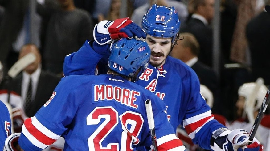 New York Rangers center Brian Boyle (22) congratulates center Dominic Moore (28) after Moore scored a goal against the Montreal Canadiens during the second period in Game 6 of the NHL hockey Stanley Cup playoffs Eastern Conference finals, Thursday, May 29, 2014, in New York. (AP Photo/Kathy Willens)