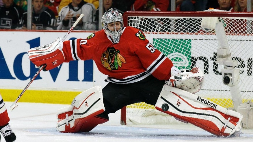 Chicago Blackhawks goalie Corey Crawford gives up a goal by Los Angeles Kings right wing Marian Gaborik during the first period in Game 5 of the Western Conference finals in the NHL hockey Stanley Cup playoffs Wednesday, May 28, 2014, in Chicago. (AP Photo/Nam Y. Huh)