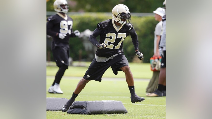 New Orleans Saints cornerback Champ Bailey (27) runs a drill during an NFL football minicamp in Metairie, La., Thursday, May 29, 2014. (AP Photo/Bill Haber)
