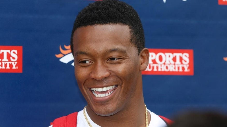 Denver Broncos wide receiver Demaryius Thomas jokes with reporters after NFL football minicamp in Englewood, Colo., on Thursday, May 29, 2014. (AP Photo/David Zalubowski)