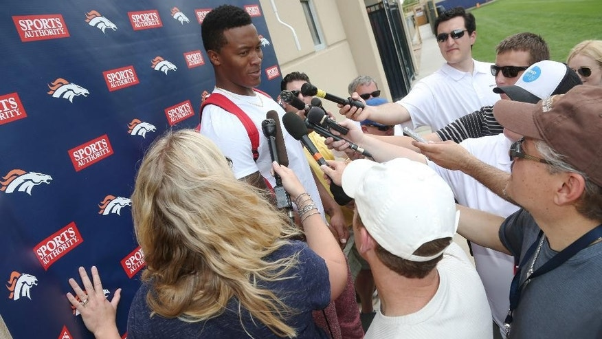 Denver Broncos wide receiver Demaryius Thomas talks to reporters after NFL football minicamp in Englewood, Colo., on Thursday, May 29, 2014. (AP Photo/David Zalubowski)