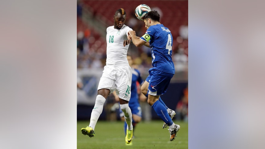 Ivory Coast's Lacina Traore, left, and Bosnia's Emir Spahic vie for the the ball during the first half in an international friendly soccer match Friday, May 30, 2014, in St. Louis. (AP Photo/Jeff Roberson)