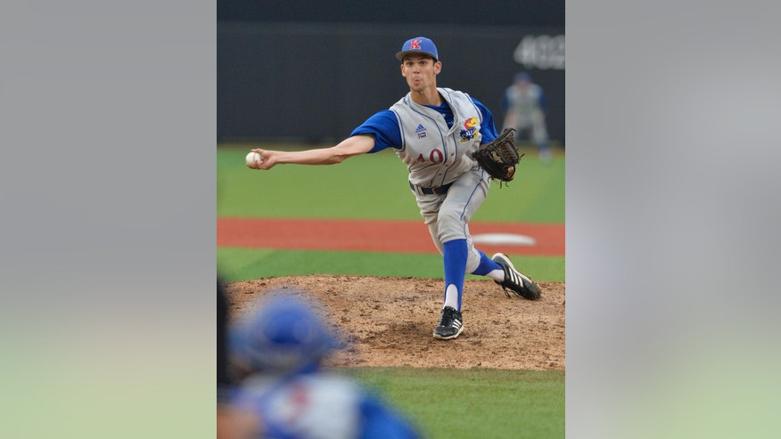 Kansas' Stephen Villines pitches to Kentucky during the eighth inning of their NCAA college baseball regional tournament game in Louisville, Ky., Friday, May 30, 2014. Kansas defeated Kentucky. (AP Photo/Timothy D. Easley)