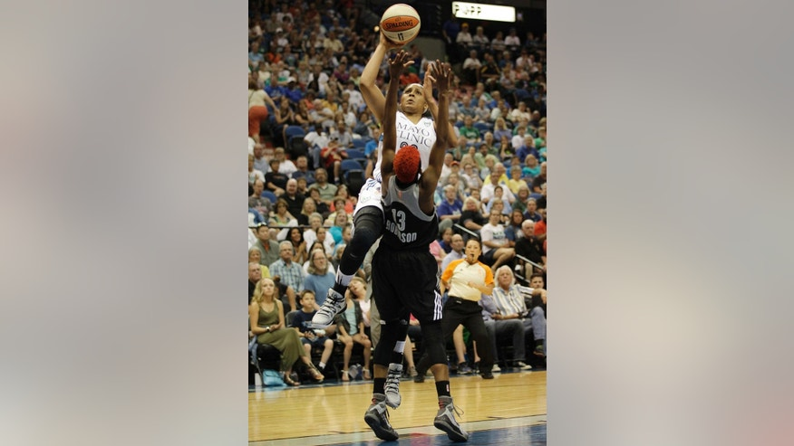 Minnesota Lynx forward Maya Moore, top, goes up for a basket against San Antonio Stars guard Danielle Robinson (13) in the first half of a WNBA basketball game on Friday, May 30, 2014, in Minneapolis. (AP Photo/Stacy Bengs)