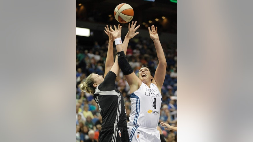 Minnesota Lynx center Janel McCarville (4) and San Antonio Stars center Jayne Appel, left, fight for a rebound ball in the first half of a WNBA basketball game on Friday, May 30, 2014, in Minneapolis. (AP Photo/Stacy Bengs)
