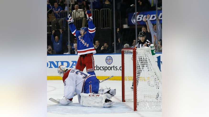 New York Rangers center Brian Boyle (22) reacts as the puck crosses the goal line against Montreal Canadiens goalie Dustin Tokarski (35) during the second period in Game 6 of the NHL hockey Stanley Cup playoffs Eastern Conference finals, Thursday, May 29, 2014, in New York. The Rangers won 1-0. (AP Photo/Kathy Willens)