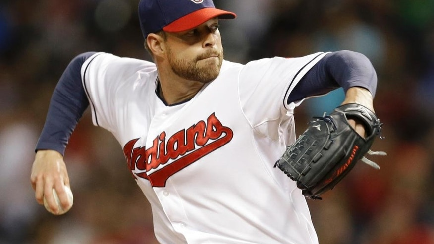 Cleveland Indians starting pitcher Corey Kluber delivers against the Colorado Rockies in the sixth inning of a baseball game Friday, May 30, 2014, in Cleveland. (AP Photo/Mark Duncan)