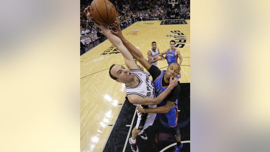San Antonio Spurs' Manu Ginobili, left, drives to the basket over Oklahoma City Thunder's Caron Butler during the second half of Game 5 of the Western Conference finals NBA basketball playoff series, Thursday, May 29, 2014, in San Antonio. San Antonio won 117-89. (AP Photo/Eric Gay)