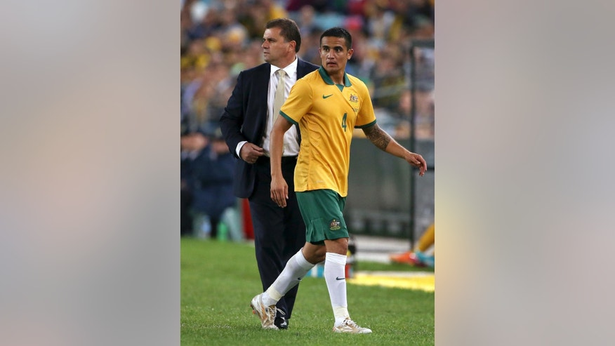 Australia's Tim Cahill, right, is substituted by coach Ange Postecoglou during their friendly soccer match in Sydney, Monday, May 26, 2014. The game is a 1-1 draw. (AP Photo/Rick Rycroft)