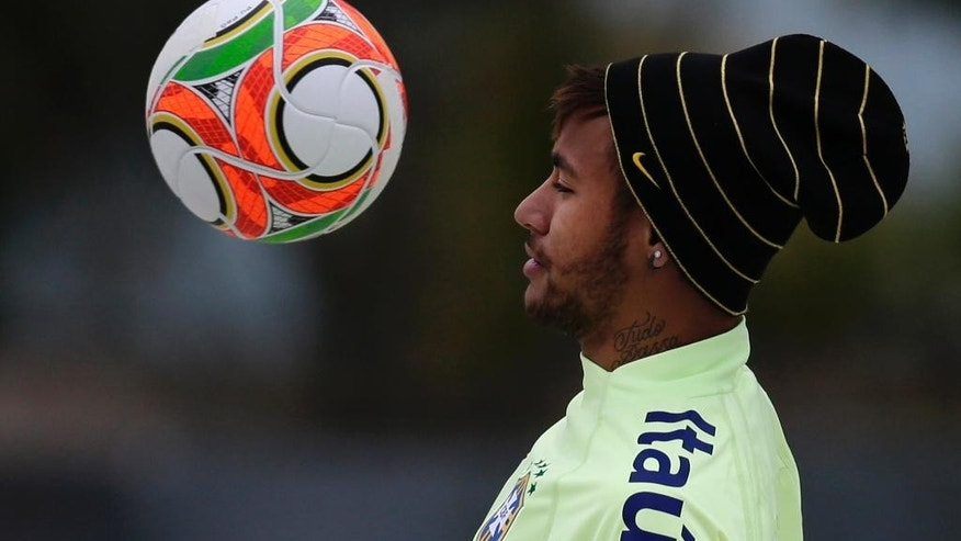 Brazil's Neymar controls the ball as he plays footvolley with his teammates during a training session at the Granja Comary training center in Teresopolis, Brazil, Thursday, May 29, 2014. Brazil will host the World Cup soccer tournament that starts in June. (AP Photo/Hassan Ammar)