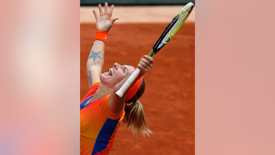 Russia's Svetlana Kuznetsova celebrates her victory over Petra Kvitova of the Czech Republic during the third round match of  the French Open tennis tournament at the Roland Garros stadium, in Paris, France, Saturday, May 31, 2014. Kuznetsova won 6-7, 6-1, 9-7. (AP Photo/Michel Spingler)