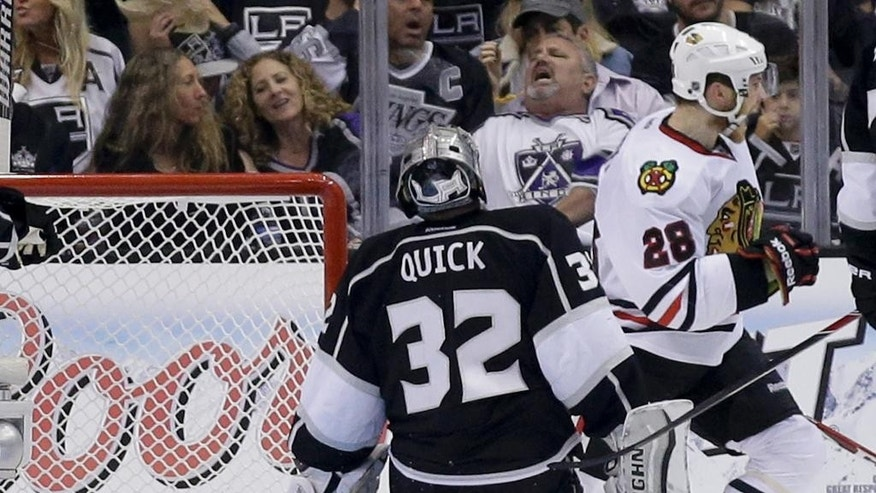 Chicago Blackhawks right wing Ben Smith, right, celebrates after scoring on Los Angeles Kings goalie Jonathan Quick during the second period of Game 6 of the Western Conference finals of the NHL hockey Stanley Cup playoffs in Los Angeles, Friday, May 30, 2014. (AP Photo/Chris Carlson)