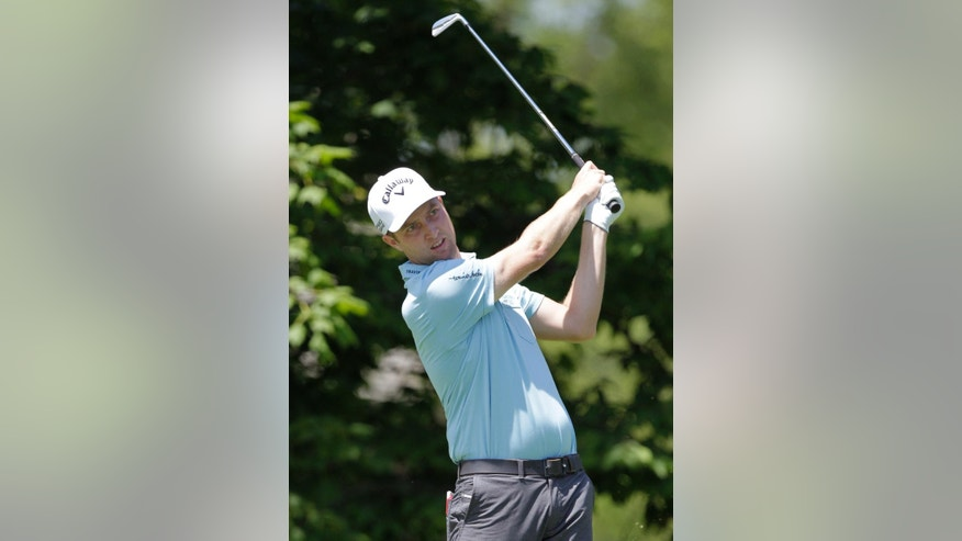 Chris Kirk tees off on the 14th hole during the second round of the Memorial golf tournament Friday, May 30, 2014, in Dublin, Ohio. (AP Photo/Jay LaPrete)