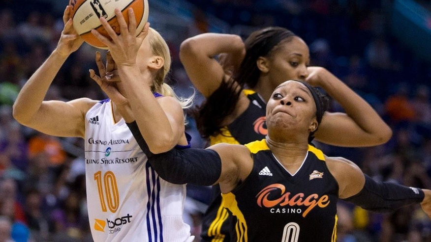 Phoenix Mercury's Anete Jekabsone-Zogota, left, is fouled by Shock's Odyessey Sims in the first half of a WNBA basketball game in Phoenix, Ariz., Friday, May 30, 2014. (AP Photo/The Arizona Republic, Patrick Breen) MARICOPA COUNTY OUT; NO SALES
