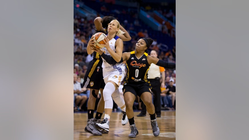 Phoenix Mercury's Anete Jekabsone-Zogota is fouled by Tulsa Shock's Odyessey Sims in the first half of a WNBA basketball game in Phoenix, Ariz., Friday, May 30, 2014. (AP Photo/The Arizona Republic, Patrick Breen) MARICOPA COUNTY OUT; NO SALES